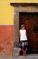 Woman in colorful Mexican doorway #5834. San Miguel de Allende Guanajuato Mexico.