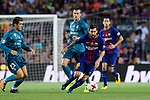 Lionel Messi of FC Barcelona (R) dribbles Gareth Bale of Real Madrid (C) during the Supercopa de Espana Final 1st Leg match between FC Barcelona and Real Madrid at Camp Nou on August 13, 2017 in Barcelona, Spain. Photo by Marcio Rodrigo Machado / Power Sport Images
