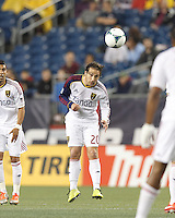 Real Salt Lake midfielder Ned Grabavoy (20) heads the ball.  In a Major League Soccer (MLS) match, Real Salt Lake (white)defeated the New England Revolution (blue), 2-1, at Gillette Stadium on May 8, 2013.