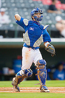 Catcher Min-Sik Kim #23 of Team Korea make a throw to first base against Team USA at Knights Stadium July 16, 2010, in Fort Mill, South Carolina.  Photo by Brian Westerholt / Four Seam Images
