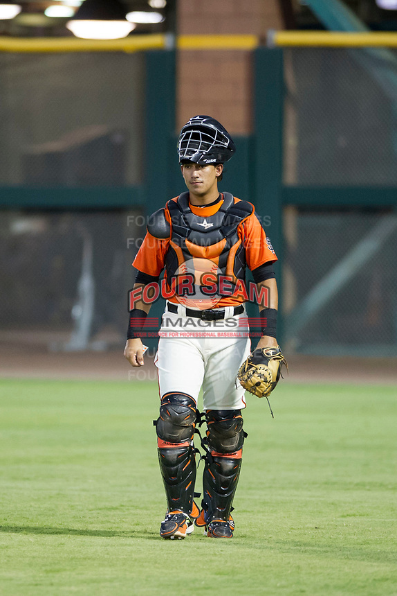 AZL Giants catcher Ricardo Genoves (15) walks to the dugout before a game against the AZL Cubs on September 5, 2017 at Scottsdale Stadium in Scottsdale, Arizona. AZL Cubs defeated the AZL Giants 10-4 to take a 1-0 lead in the Arizona League Championship Series. (Zachary Lucy/Four Seam Images)