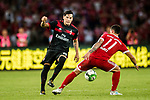 AC Milan Defender Gustavo Gomez (L) plays against Bayern Munich Midfielder James Rodríguez (R) during the 2017 International Champions Cup China  match between FC Bayern and AC Milan at Universiade Sports Centre Stadium on July 22, 2017 in Shenzhen, China. Photo by Marcio Rodrigo Machado / Power Sport Images