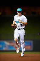 Salt River Rafters left fielder Jake McCarthy (5), of the Arizona Diamondbacks organization, jogs off the field between innings of an Arizona Fall League game against the Mesa Solar Sox on September 19, 2019 at Salt River Fields at Talking Stick in Scottsdale, Arizona. Salt River defeated Mesa 4-1. (Zachary Lucy/Four Seam Images)
