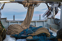 """A picture taken on November 4, 2015 shows a net on a fishing boat off the coast of Villajoyosa . Ecoalf, a Spanish Madrid-based firm founded in 2010, has already launched """"a new generation"""" of clothes and accessories made from plastic bottles, old fishing nets and used tires found on land.   © Pedro ARMESTRE"""