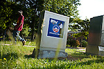 May 6, 2008. Durham, NC.. With the close North Carolina primary battle between Senators Hillary Clinton and Barack Obama, voters hit the polls to try and bring closure to this highly contested state and divide the delegates between the 2 candidates. . A man passes an Obama poster on a power box in Durham.
