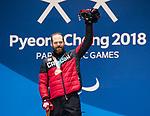 Kurt Oatway, PyeongChang 2018 - Para Alpine Skiing // Ski para-alpin.<br /> Kurt Oatway collects the gold medal in the men's sitting super-G // Kurt Oatway remporte sa médaille d'or en super-G assis masculin. 11/03/2018.