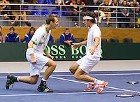 05-03-11, Tennis, Oekraine, Kharkov, Daviscup, Oekraine - Netherlands, Thiemo de Bakker/Robin Haase  gaan op hun knieen na het winnen van de dubbel