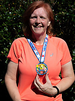 Sidcup, Kent, England 8th May 2020. Nicola Parslow with her NHS Medal for a virtual 10k run during the UK Lockdown due to the Coronavirus pandemic. Photo by Alan Stanford / PRiME Media Images