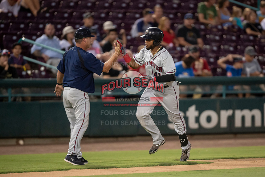 Lancaster JetHawks manager Scott Little high fives Luis Castro (41) as he rounds the bases after hitting a home run during a California League game against the Lake Elsinore Storm on September 2, 2019 at The Diamond in Lake Elsinore, California. Lake Elsinore defeated Lancaster 4-3. (Zachary Lucy/Four Seam Images)