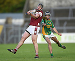 Alan O Neill of St Joseph's Doora Barefield in action against Danny Reddan of Broadford during their Intermediate county final in Cusack Park. Photograph by John Kelly.