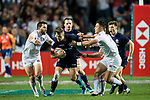 Gavin Lowe of Scotland is tackled by England's players during their Pool C match between England and Scotland as part of the HSBC Hong Kong Rugby Sevens 2018 on 06 April 2018, in Hong Kong, Hong Kong. Photo by Marcio Rodrigo Machado / Power Sport Images