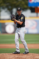 Akron RubberDucks starting pitcher Shao-Ching Chiang (29) gets ready to deliver a warmup pitch during a game against the Erie SeaWolves on August 27, 2017 at UPMC Park in Erie, Pennsylvania.  Akron defeated Erie 6-4.  (Mike Janes/Four Seam Images)