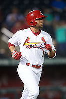 Springfield Cardinals shortstop Aledmys Diaz (16) runs to first during a game against the Frisco RoughRiders  on June 3, 2015 at Hammons Field in Springfield, Missouri.  Springfield defeated Frisco 7-2.  (Mike Janes/Four Seam Images)