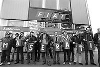 - Milan, workers of Innocenti - Maserati cars factory demonstrate in front of FIAT headquarters against the dismissals for the plant closing (December 1992)....- Milano, gli operai della fabbrica di automobili Innocenti - Maserati in manifestazione davanti alla sede FIAT contro i licenziamenti per la chiusura dello stabilimento (dicembre 1992)