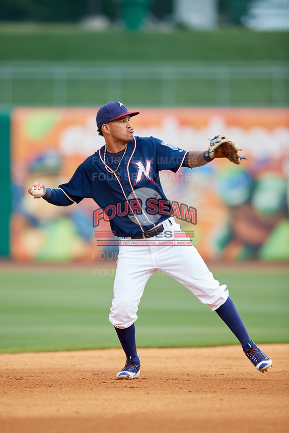 Northwest Arkansas Naturals shortstop Humberto Arteaga (6) throws to first base during a game against the Midland RockHounds on May 27, 2017 at Arvest Ballpark in Springdale, Arkansas.  NW Arkansas defeated Midland 3-2.  (Mike Janes/Four Seam Images)