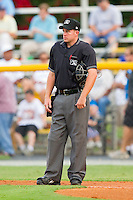 Home plate umpire Drew Freed between innings of the Appalachian League game between the Danville Braves and the Burlington Royals at Burlington Athletic Park on July 18, 2012 in Burlington, North Carolina.  The Royals defeated the Braves 4-3 in 11 innings.  (Brian Westerholt/Four Seam Images)
