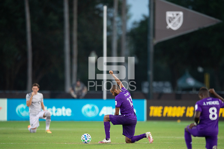 LAKE BUENA VISTA, FL - JULY 25: Tesho Akindele #13 of Orlando City SC before the game during a game between Montreal Impact and Orlando City SC at ESPN Wide World of Sports on July 25, 2020 in Lake Buena Vista, Florida.