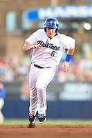 Tulsa Drillers outfielder Jared Simon (6) runs the bases during a game against the Midland RockHounds on May 30, 2014 at ONEOK Field in Tulsa, Oklahoma.  Tulsa defeated Midland 7-1.  (Mike Janes/Four Seam Images)