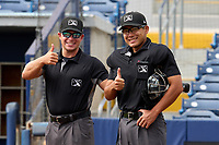 Umpires Denver Dangerfield and Nobuoki Yasuta before a game between the FCL Pirates Black and FCL Rays on August 3, 2021 at Charlotte Sports Park in Port Charlotte, Florida.  (Mike Janes/Four Seam Images)