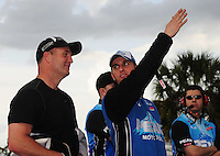 Mar. 9, 2012; Gainesville, FL, USA; NHRA top fuel dragster driver T.J. Zizzo (right) with Bob Vandergriff Jr during qualifying for the Gatornationals at Auto Plus Raceway at Gainesville. Mandatory Credit: Mark J. Rebilas-