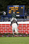 August 08, 2009: Trevor Breen (IRL) and Susie's Lad clear the wall fence. Land Rover International Puissance. Failte Ireland Horse Show. The RDS, Dublin, Ireland.