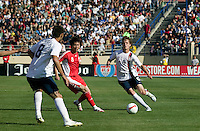 USA's Michael Bradley slides a pass to Clint Dempsey. The USA defeated China, 4-1, in an international friendly at Spartan Stadium, San Jose, CA on June 2, 2007.
