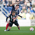 Falkirk's Sean Higgins goes into the back of Pars' Josh Falkingham  ...