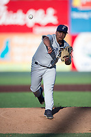 Tri-City Dust Devils relief pitcher Efrain Contreras (25) follows through on his delivery during a Northwest League game against the Everett AquaSox at Everett Memorial Stadium on September 3, 2018 in Everett, Washington. The Everett AquaSox defeated the Tri-City Dust Devils by a score of 8-3. (Zachary Lucy/Four Seam Images)