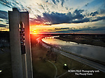 Aerial of Carillon Bell Tower with river at sunset