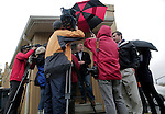 CORNELIUS, NC - NOVEMBER 1:  North Carolina candidate for U.S. Senate Thom Tillis, center, talks to reporters in the rain after participating in early voting at Cornelius Town Hall in Cornelius, NC, on Saturday, November 1, 2014.  (Photo by Ted Richardson/For The Washington Post)