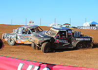 Apr 17, 2011; Surprise, AZ USA; LOORRS driver Austin Kimbrell (88) is spun by Ryan Beat (51) during round 4 at Speedworld Off Road Park. Mandatory Credit: Mark J. Rebilas-