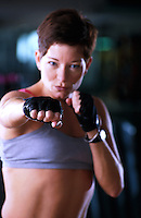 Portrait of a woman doing boxing aerobics.