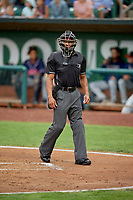 Umpire Quentin Motte handles the calls behind the plate during the game between the Ogden Raptors and the Rocky Mountain Vibes at Lindquist Field on July 4, 2019 in Ogden, Utah. The Raptors defeated the Vibes 4-2. (Stephen Smith/Four Seam Images)