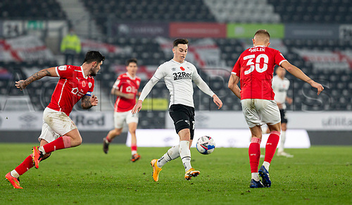 7th November 2020; Pride Park, Derby, East Midlands; English Football League Championship Football, Derby County versus Barnsley; Tom Lawrence of Derby County plays the ball forward past Michal Helik of Barnsley