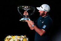 23rd August 2020, Boston, MA, USA;  Dustin Johnson, of the United States, admires the trophy after winning The Northern Trust  at TPC Boston in Norton, Massachusetts.