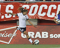 USWNT midfielder Tobin Heath (17) passes the ball. In an international friendly, the U.S. Women's National Team (USWNT) (white/blue) defeated Korea Republic (South Korea) (red/blue), 4-1, at Gillette Stadium on June 15, 2013.