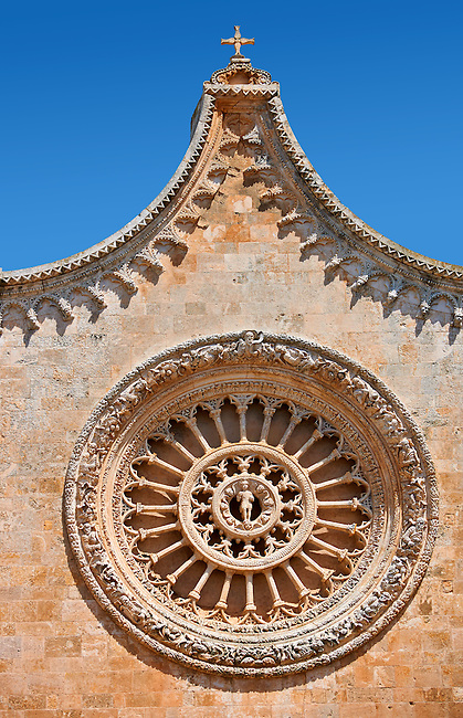 Rose Window on the The Italian Gothic medieval Cathedral of Ostuni built between 1569-1495  .Ostuni, The White Town, Puglia, Italy.
