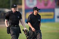Umpires Patrick Faerber and JP Perez walk onto the field before a Pioneer League game between the Missoula Osprey and the Grand Junction Rockies at Ogren Park Allegiance Field on August 21, 2018 in Missoula, Montana. The Missoula Osprey defeated the Grand Junction Rockies by a score of 2-1. (Zachary Lucy/Four Seam Images)