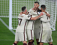 Football: Europa League - quarter final 2nd leg AS Roma vs Ajax, Olympic Stadium. Rome, Italy, March 15, 2021.<br /> Roma's Edin Dzeko (behind C) celebrates after scoring with his teammates Lorenzo Pellegrini (R), Riccardo Calafiori (C), Jordan Veretout (L)  during the Europa League football match between Roma at Rome's Olympic stadium, Rome, on April 15, 2021.  <br /> UPDATE IMAGES PRESS/Isabella Bonotto
