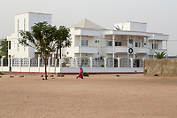 Senegal, Touba.  Modern House with a Religious Leader's Picture above the Entrance.