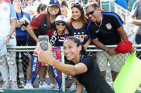 Cary, NC - Sunday October 22, 2017: Christen Press takes a selfie with fans after an International friendly match between the Women's National teams of the United States (USA) and South Korea (KOR) at Sahlen's Stadium at WakeMed Soccer Park. The U.S. won the game 6-0.
