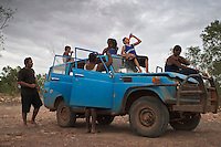 "Derek Counselor showed up with this bush truck full of kids (above) to go swimming.  I asked Counselor if he was afraid of the crocs that were just up river.  He said ""of course I am, why do you think I brought all these kids?""  I had asked Carol's group that same question and they said of course we're afraid of crocs, there's a big one just up river... we've seen it... Carol and her friends had their dog, Baylor, in the water with them.  A dog is more than just a pet up here, it is a security blanket.  Crocs can not resist a dog.  If a dog is in a group of people swimming, it will be the first to go.  You see folks walking along rivers and even the ocean with their dogs... the dog gets them out the door to take a walk, but it also protects them."