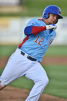 Tennessee Smokies catcher Kyle Schwarber (12) runs to third during a game against the Chattanooga Lookouts on April 25, 2015 in Kodak, Tennessee. The Smokies defeated the Lookouts 16-10. (Tony Farlow/Four Seam Images)