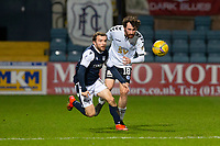 16th March 2021; Dens Park, Dundee, Scotland; Scottish Championship Football, Dundee FC versus Ayr United; Paul McMullan of Dundee races for the ball with Joe Chalmers of Ayr United