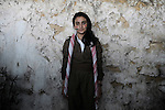 20/03/15 -- Akre, Iraq -- Mahbuba Mihvan Adel, 13, in Akre dressed in traditional clothes to celebrate Newroz