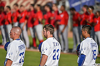 Clint Freeman (23), Nick Dean (22) and Reymundo Torres (18) of the Ogden Raptors before the game against the Orem Owlz in Pioneer League action at Lindquist Field on June 18, 2015 in Ogden, Utah. This was Opening Night play of the 2015 Pioneer League season.  (Stephen Smith/Four Seam Images)