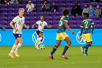 ORLANDO, FL - JANUARY 18: Crystal Dunn #19 of the USWNT dribbles during a game between Colombia and USWNT at Exploria Stadium on January 18, 2021 in Orlando, Florida.