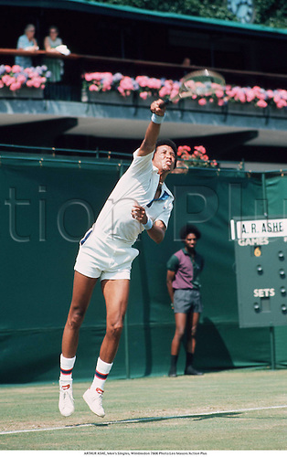 June 1976. Wimbledon, London England. ARTHUR ASHE (USA) serves during the Men's Singles, Wimbledon tennis tournament