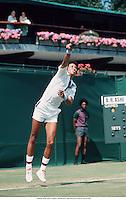 June 1976. Wimbledon, London England. ARTHUR ASHE (USA) serves during the Men's Singles, Wimbledon tennis tournament
