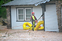 Bella Vista and Rogers Fire Department water rescue personnel assisted Little FLock in rescuing a family from 1626 Rustic Dr., Little Flock, as well as two family members who were outside the house during Wednesday mornings rain storms.<br /> (Pea Ridge Times/Annette Beard)